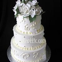 Buttercream wedding cake with scroll work and sugar roses  by Soraya Avellanet