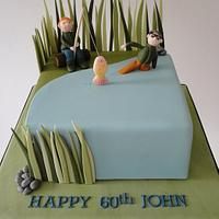 Fishing style cake with long grass