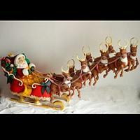 Santa with his flying reindeers