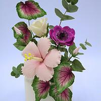 Cake with Hibiscus, Rose, Anemone, Leaf Begonia and Eucalyptus.