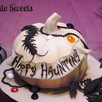 White pumpkin and creepy crawlers Halloween cake