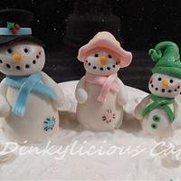 Christmas fruit cake with edible snow family