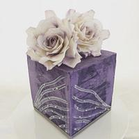 Cube cake with white roses