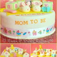 Booties and Rattle - Baby Shower Cake by KnKBakingCo
