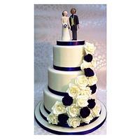 Cream and purple wedding cake