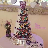 Multi coloured butterfly wedding cake