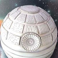 Death Star cake with airbrushed galaxy board and backdrop