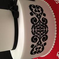 Big red flowers and black stencil cake by Jen C