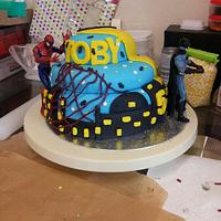 1st attempt at a batman and spiderman cake with cake pops to match. by sinisterbaker