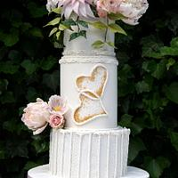 White wedding cake and flowers