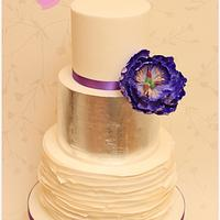 Silver leaf and open peony wedding cake