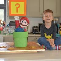 Super Mario block busting cake. by AmyLea