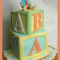 Baby ABC Blocks Cake with a Little Boy Topper ~