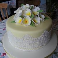 frangipani cake with cake lace