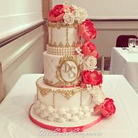 Coral, white and gold wedding cake