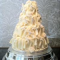 White chocolate rose and cherub frill wedding cake