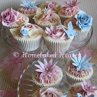 Dusky pink and blue birthday cupcakes