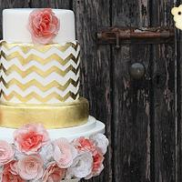Gold chevron wedding cake with patterned wafer paper flowers