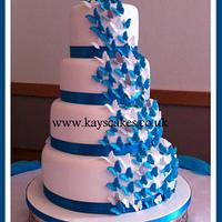 Deep Turquoise & White Butterfly Cascade Wedding Cake by Kays Cakes
