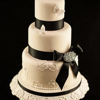 Brush embroidery, butterfly, black bow and brooch wedding cake