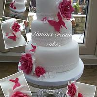 Hot pink and white butterfly and lace wedding cake x