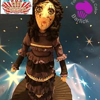 Freaky Fiona the haunted broken doll from the haunted house room at cake carnival by For goodness cake barlick