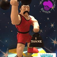 Stromboli the strong man from the fairground at twilight cake carnival room