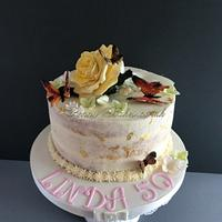 Butterflies and rose cake