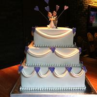 Wedding cake with drapes and hearts by Cakesue