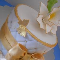 Gold and white, orchid birthday cake.