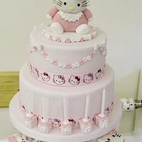 Hello Kitty 2 tier birthday cake and matching cupcakes