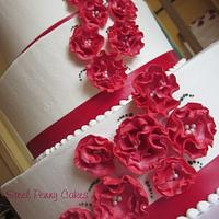 Red ruffle flower wedding cake