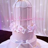 Bird cake and roses wedding cake