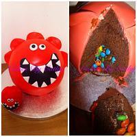 Comic relief red nose piñata cake