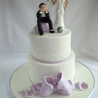 Lilac wedding cake with novelty sugar paste couple