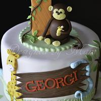 jungle themed 1st birthday cake by designed by mani