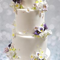 wedding cake with flower posies & clay toppers