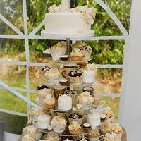 Vintage style cake and cupcakes at wedding.