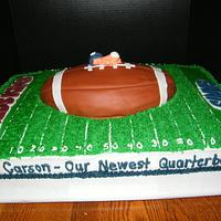 Football themed baby shower cake by Judy Remaly