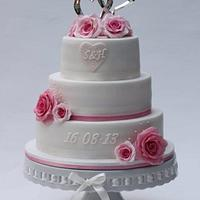 Wedding cake with pink sugar roses