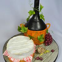 A bottle of wine and a camembert cheese