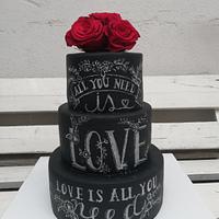 Black wedding cake with chalkboard effect