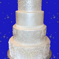 Pearl white wedding cake: ruffles flowers, old lace, simple level and sequin