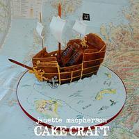 Pirate ship treasure map cake