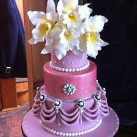 Pink jeweled wedding cake with gum paste cattleya orchids