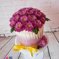 Violet cake with chrysanthemums