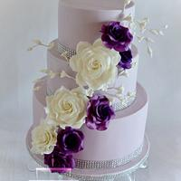 Purple wedding cake with roses