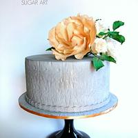 Grey textured cake with sugar flowers