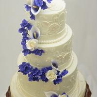 White Wedding Cake with Purple Sugar Flowers