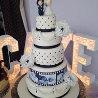 Ivory and black film strip wedding cake